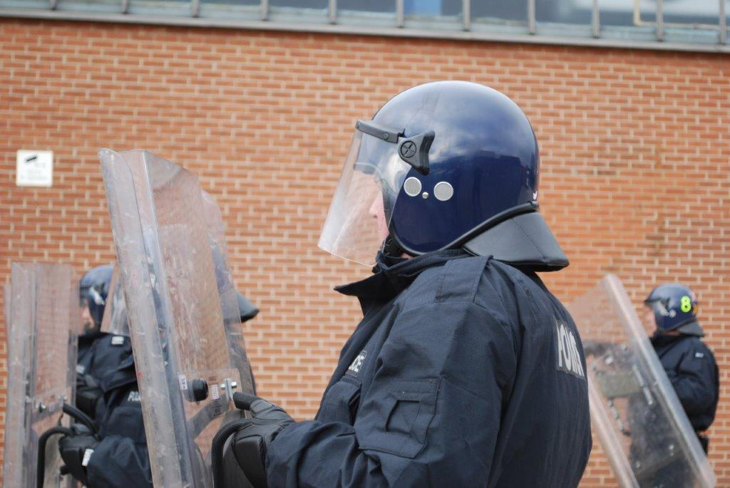 Officers training with riot equipment